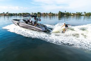 Ski boat with wakeboarder